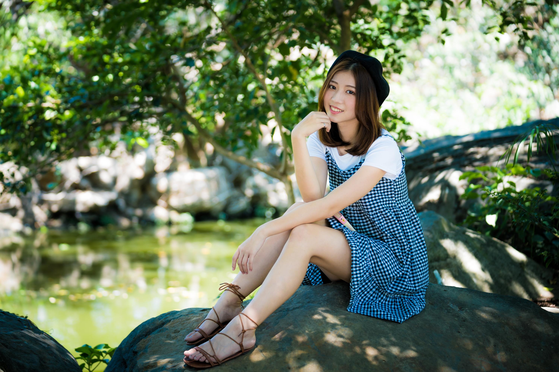 https://get.wallhere.com/photo/Asian-women-brunette-women-outdoors-depth-of-field-looking-at-viewer-model-sitting-dress-sandals-berets-rocks-water-smiling-1433757.jpg