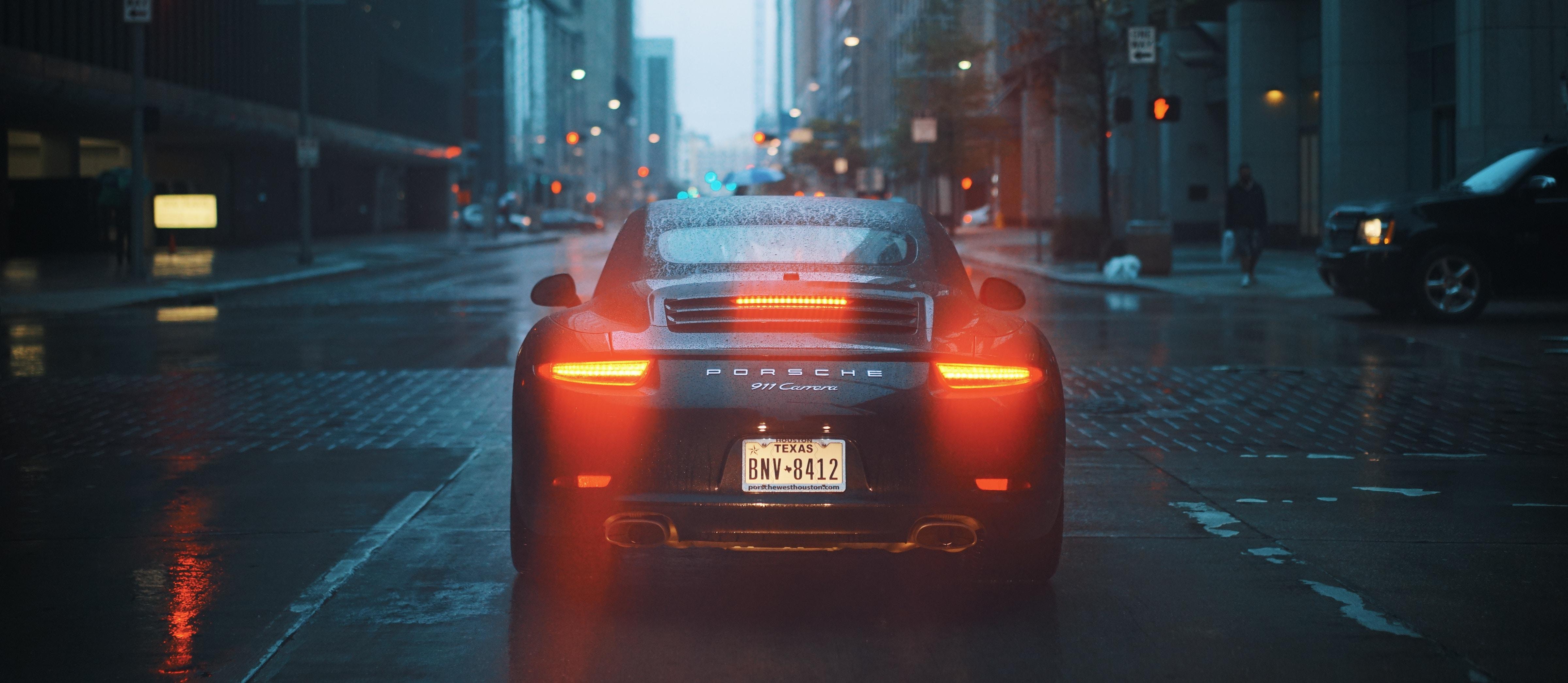 Porsche Porsche 911 Carrera S sports car Tailights bokeh urban rain
