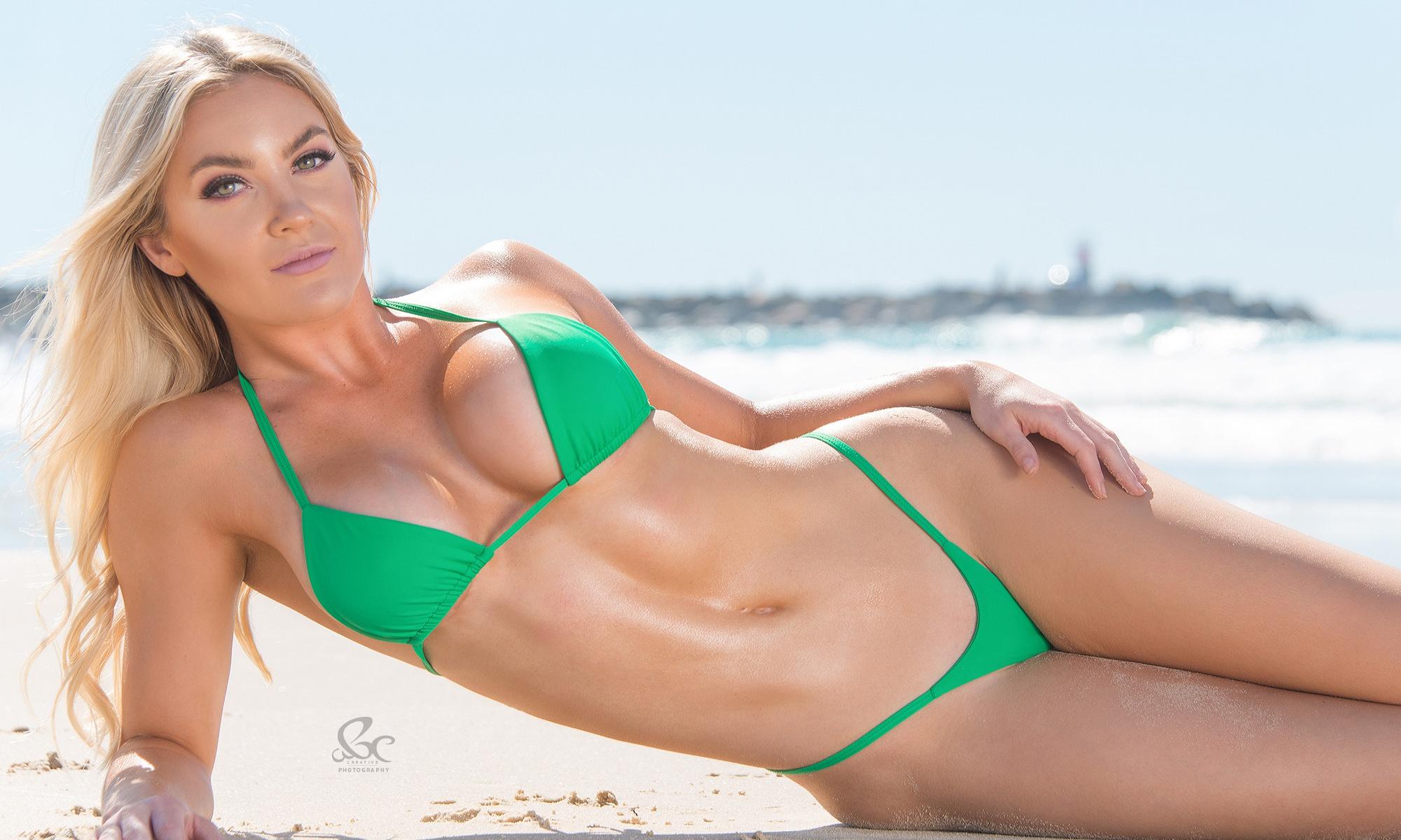 Beautiful, Blonde Female Model In Bikini On Background Of Pool Stock Image