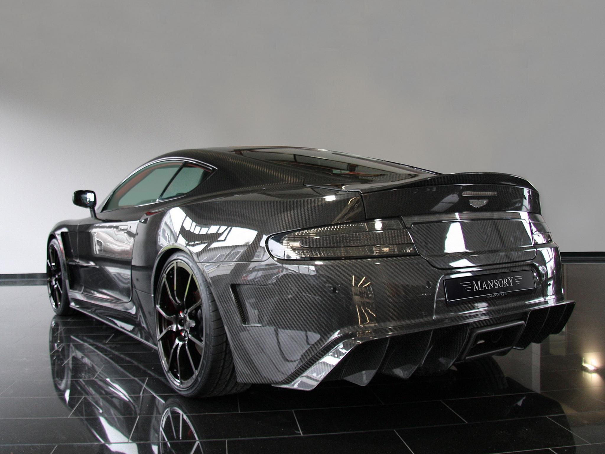 Hintergrundbilder Schwarz Auto Fahrzeug Rückansicht Sportwagen Mansory Aston Martin Aston Martin Dbs Coupe Leistungsauto Aston Martin Vanquish 2009 Rad Stil Supercar Reflektiert Kohlenstoff Landfahrzeug Automobil Design Automobil