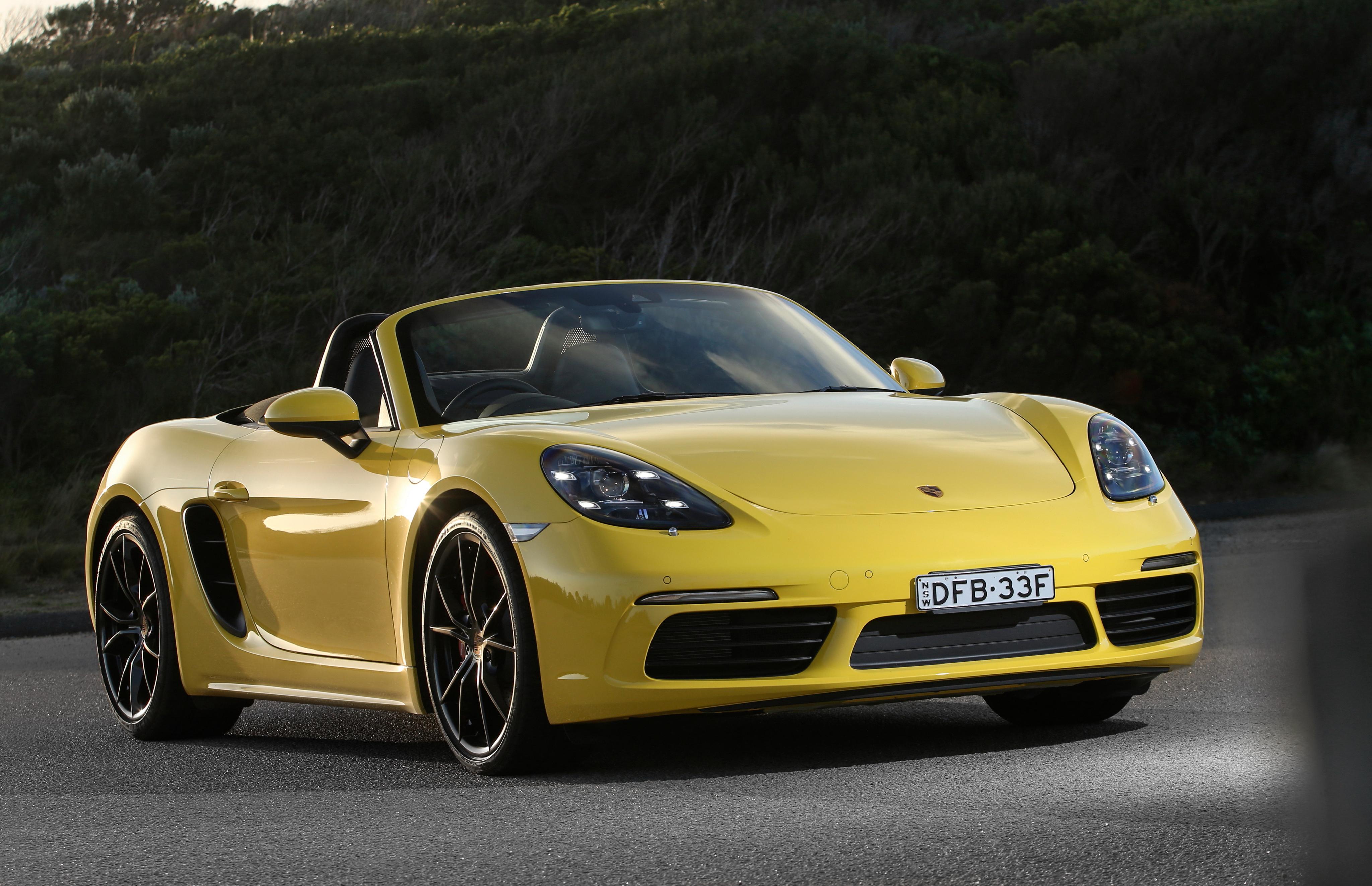 car vehicle yellow Porsche sports car coupe Convertible performance car Porsche Boxster Porsche Cayman wheel supercar