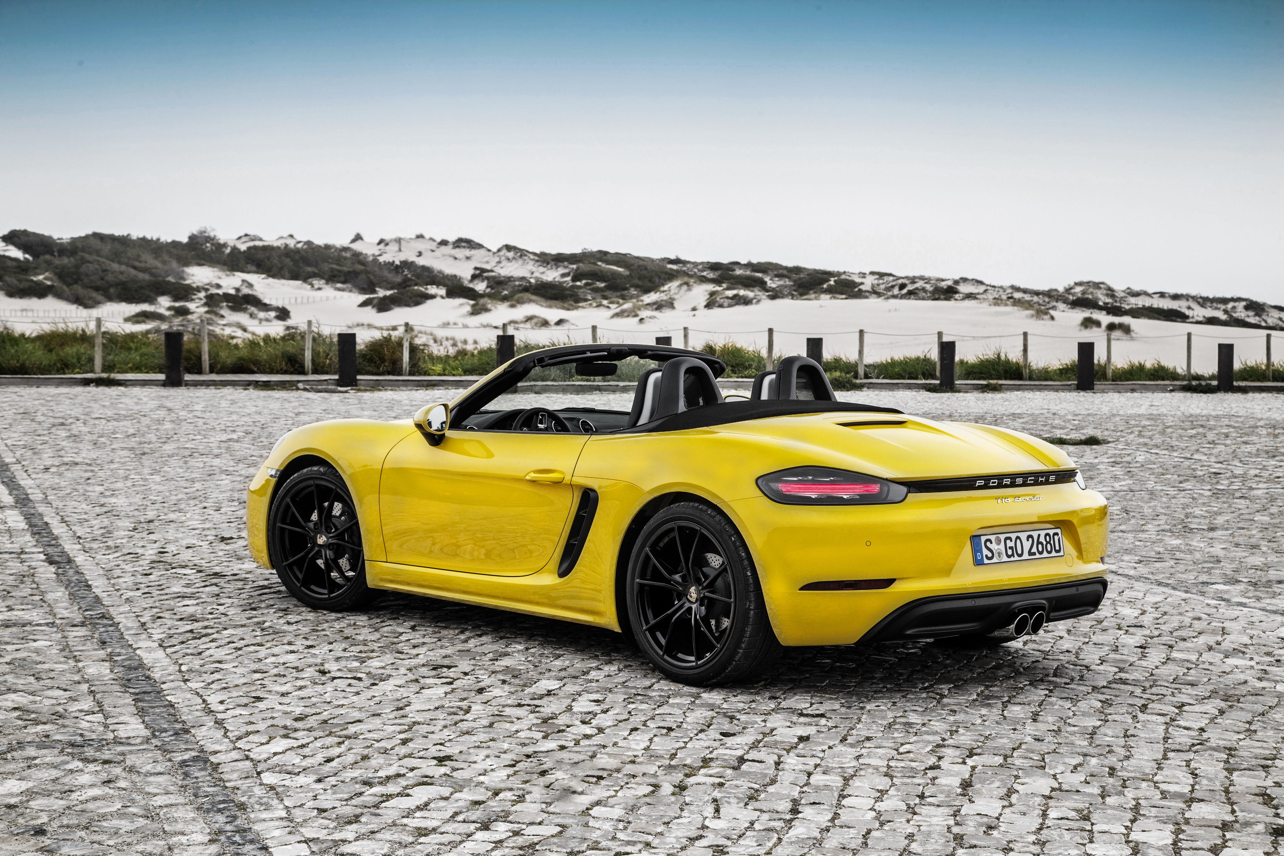 car vehicle yellow Porsche sports car coupe Convertible performance car Porsche Boxster wheel supercar land vehicle