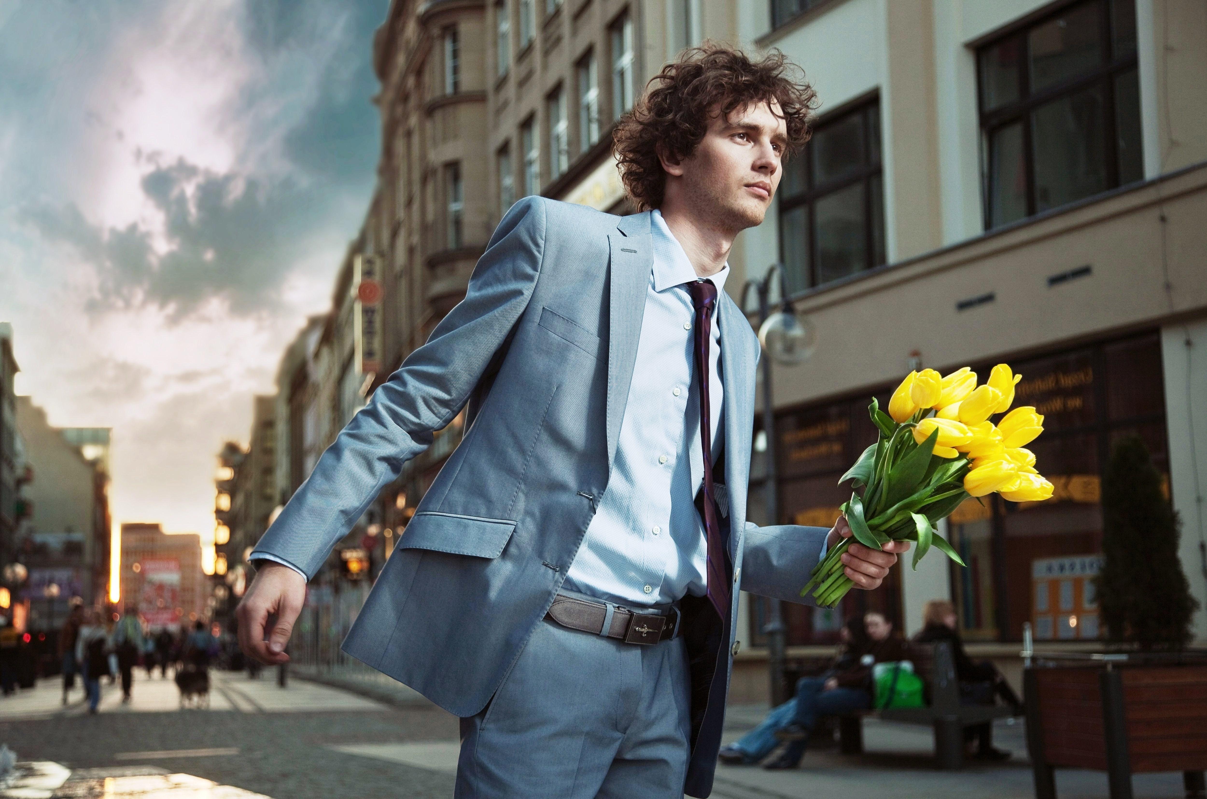 costume man flowers hair yellow tie