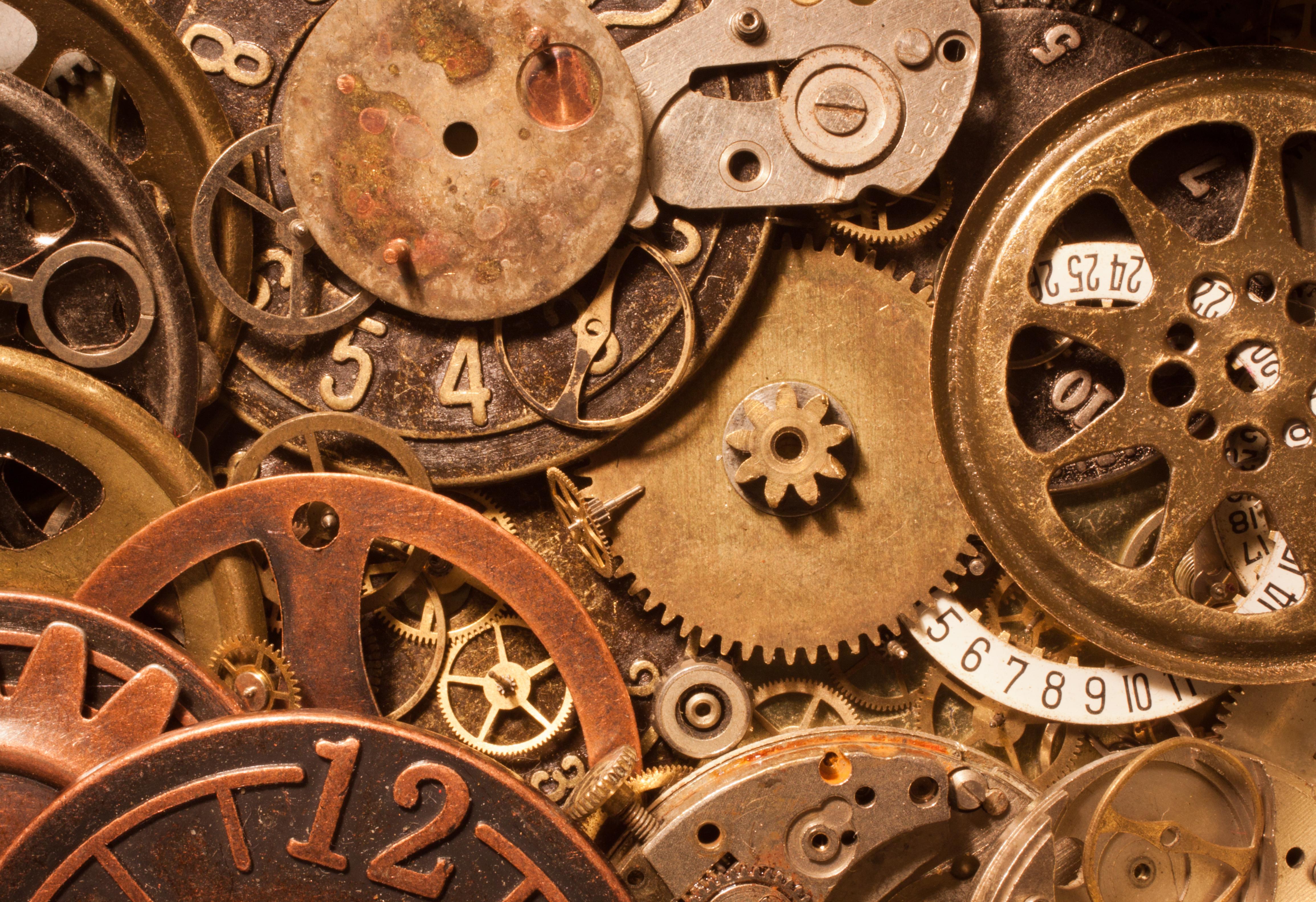 dettaglio macro orologio metallo orologio ruote ottone ingranaggi quadranti  Ruote dentate
