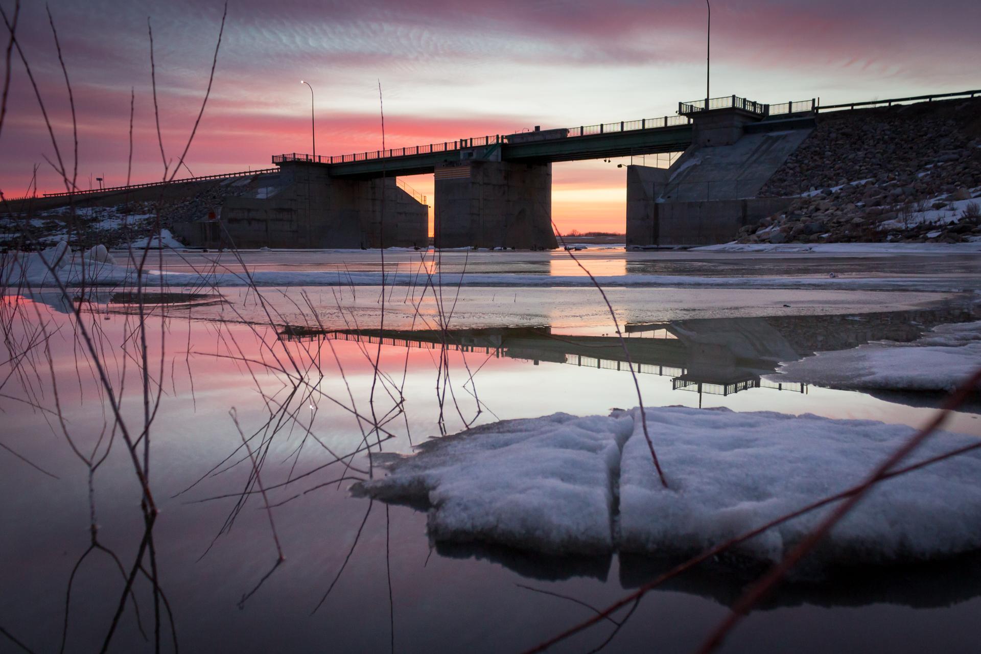 floodway Winnipeg manitoba Canada Canadian flood sunrise ice melt cold