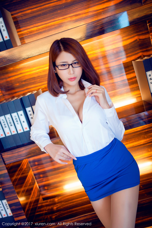 wallpaper   office girl  open shirt  cleavage  blue skirt