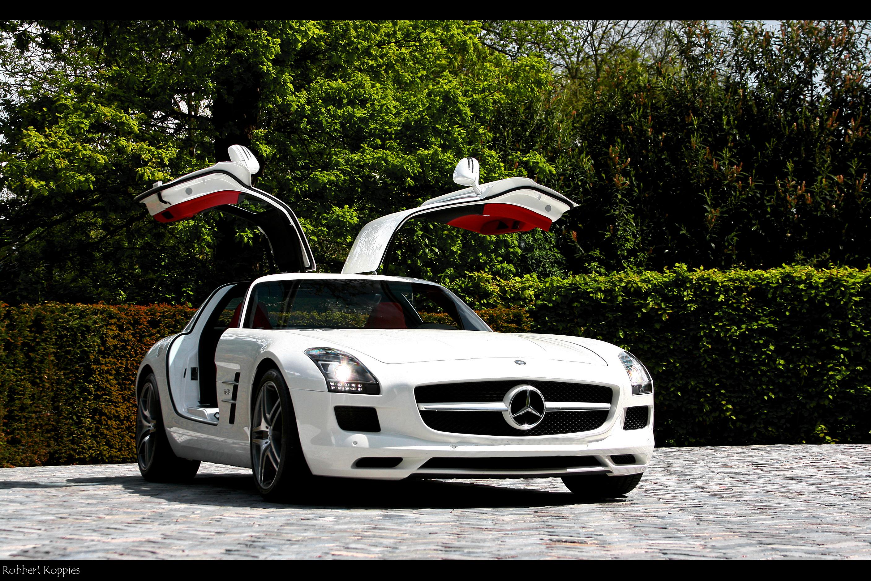 https://get.wallhere.com/photo/white-car-red-interior-vehicle-Mercedes-Benz-sports-car-Mercedes-Benz-SLS-AMG-performance-car-Hypercar-shooting-AMG-Benz-photo-photoshoot-wheel-62-rim-supercar-mercedes-foto-shoot-doors-mercedesbenz-gullwing-interieur-sls-rood-wit-63-65-land-vehicle-automotive-design-automotive-exterior-luxury-vehicle-family-car-bumper-compact-car-motor-vehicle-automotive-tire-personal-luxury-car-city-car-auto-part-deur-gulwing-witte-fotoshoot-deuren-automotive-wheel-system-834239.jpg