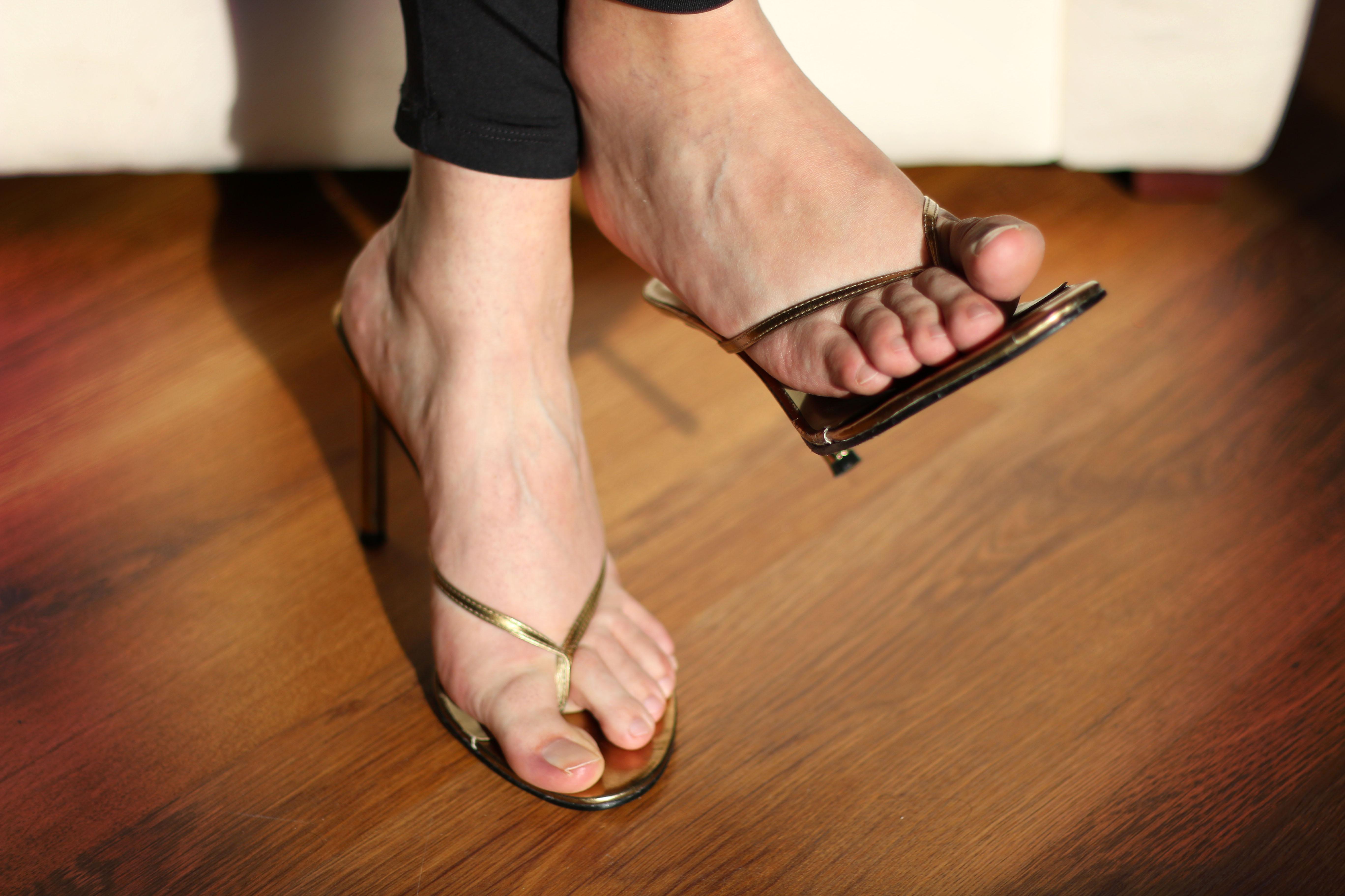 Sexy feet in high heel sandals