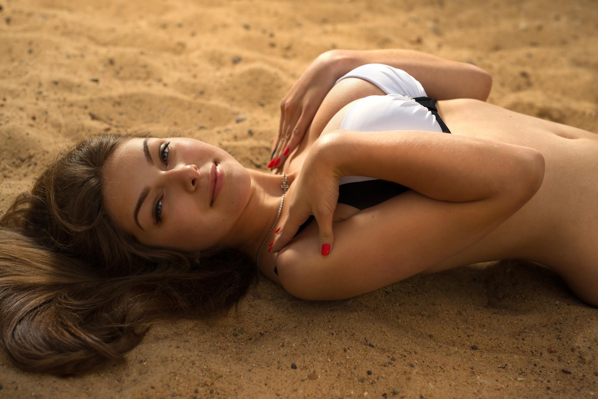 Sexy topless woman posing beach sand stock photo