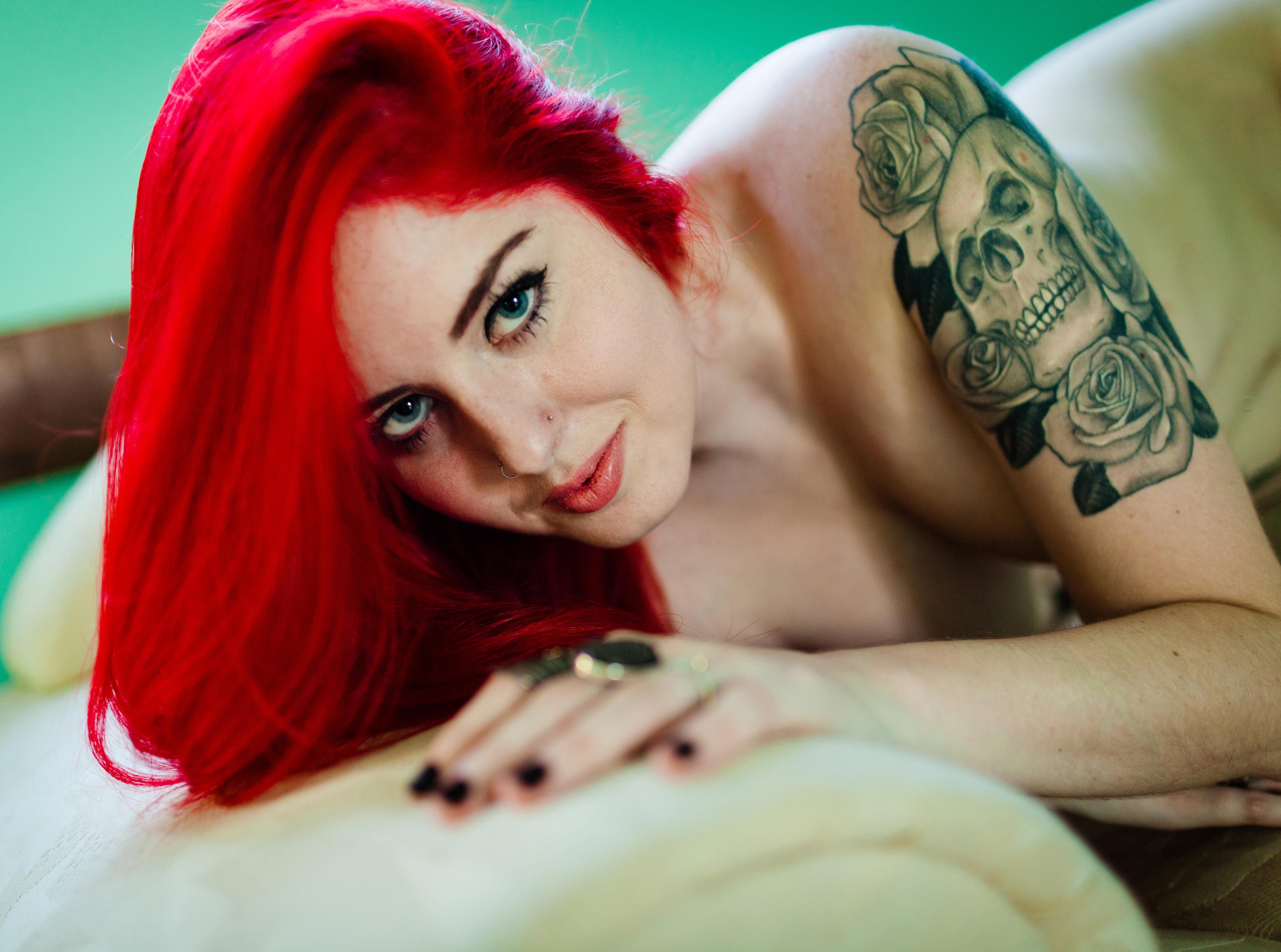 naked redhead tattoo girl