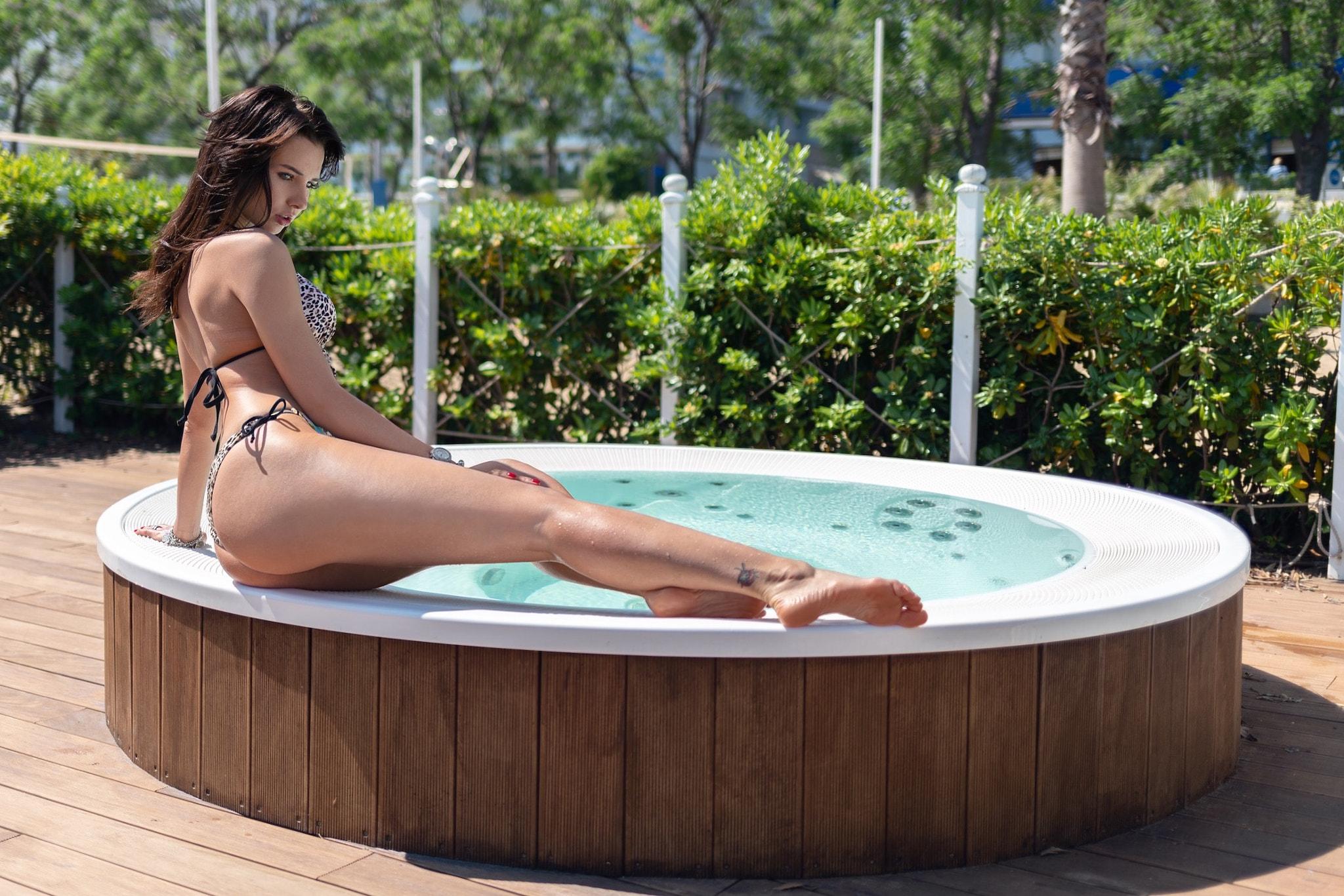 Girls hits hot tub